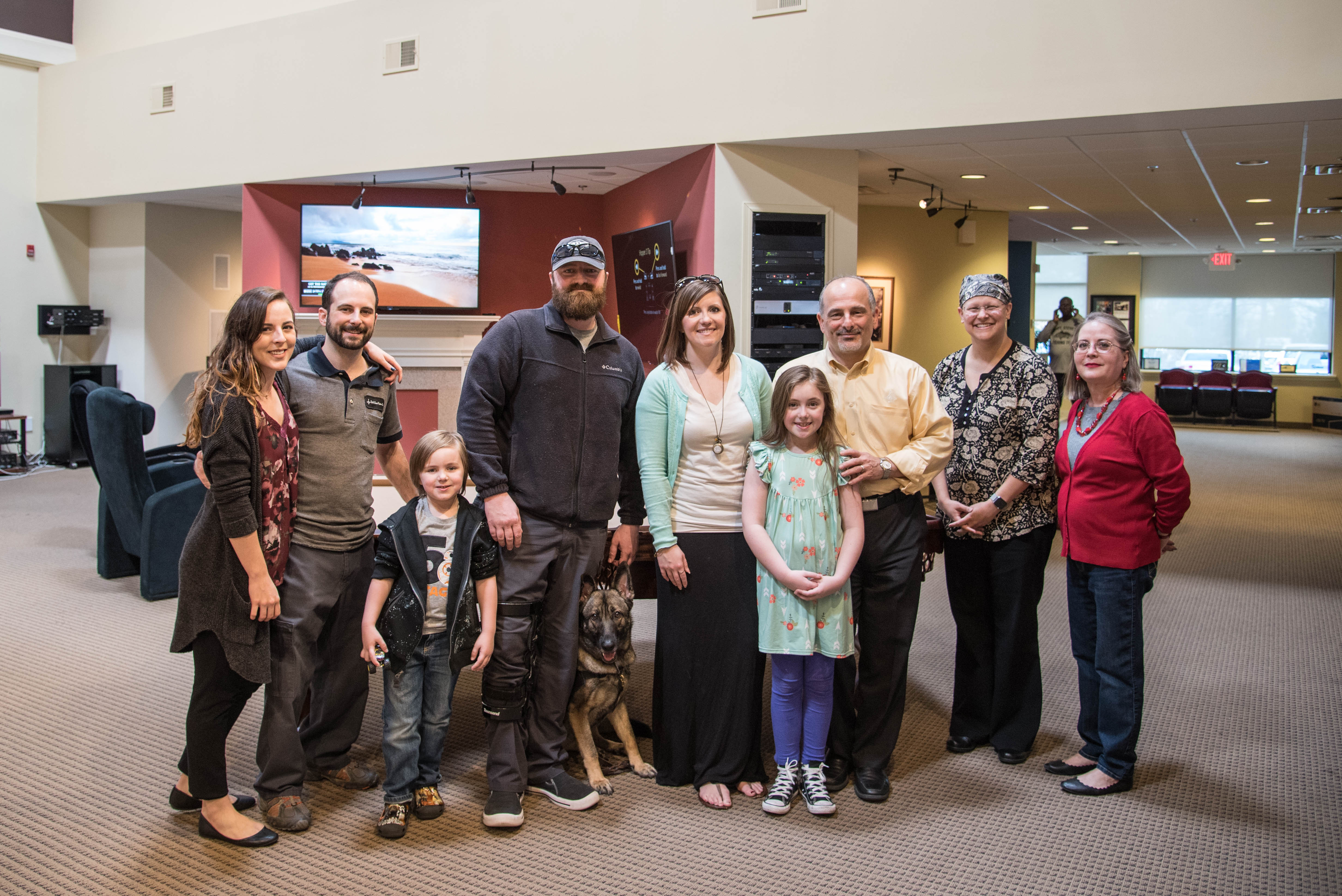 The Goodrich family, the Sight & Sound team, and others celebrate the new home.