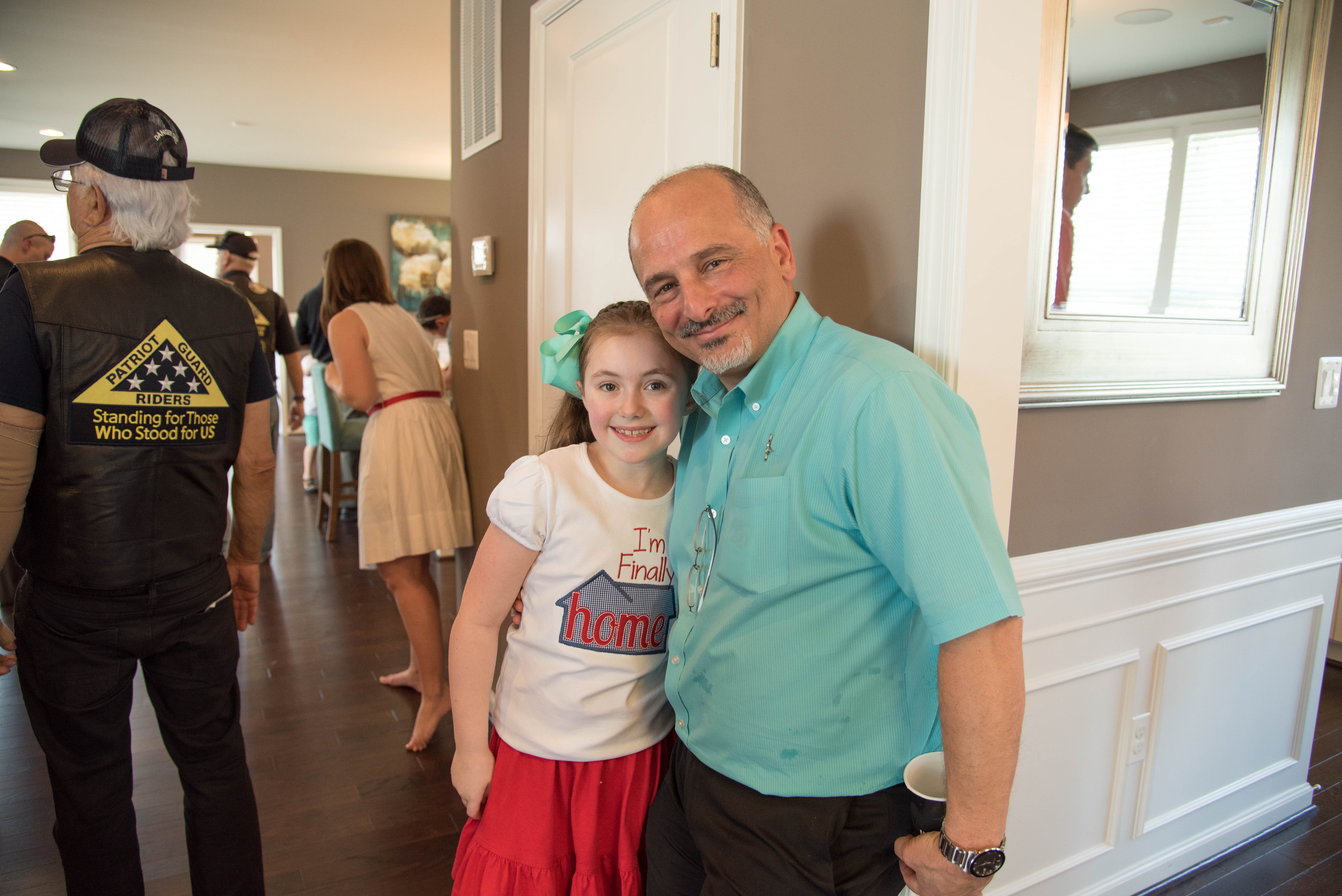Kris Kaymanesh, President of Sight & Sound Systems, with Michael Goodrich's daughter, Lucy.