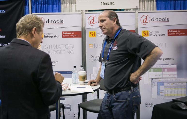 D-Tools vendor programs manager Sean Carlin holds a meeting with a guest at his booth.