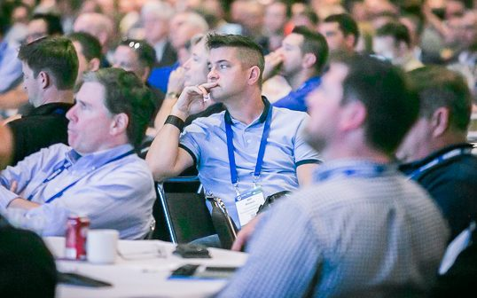 Total Tech Summit attendees listen to Khemka's keynote address.