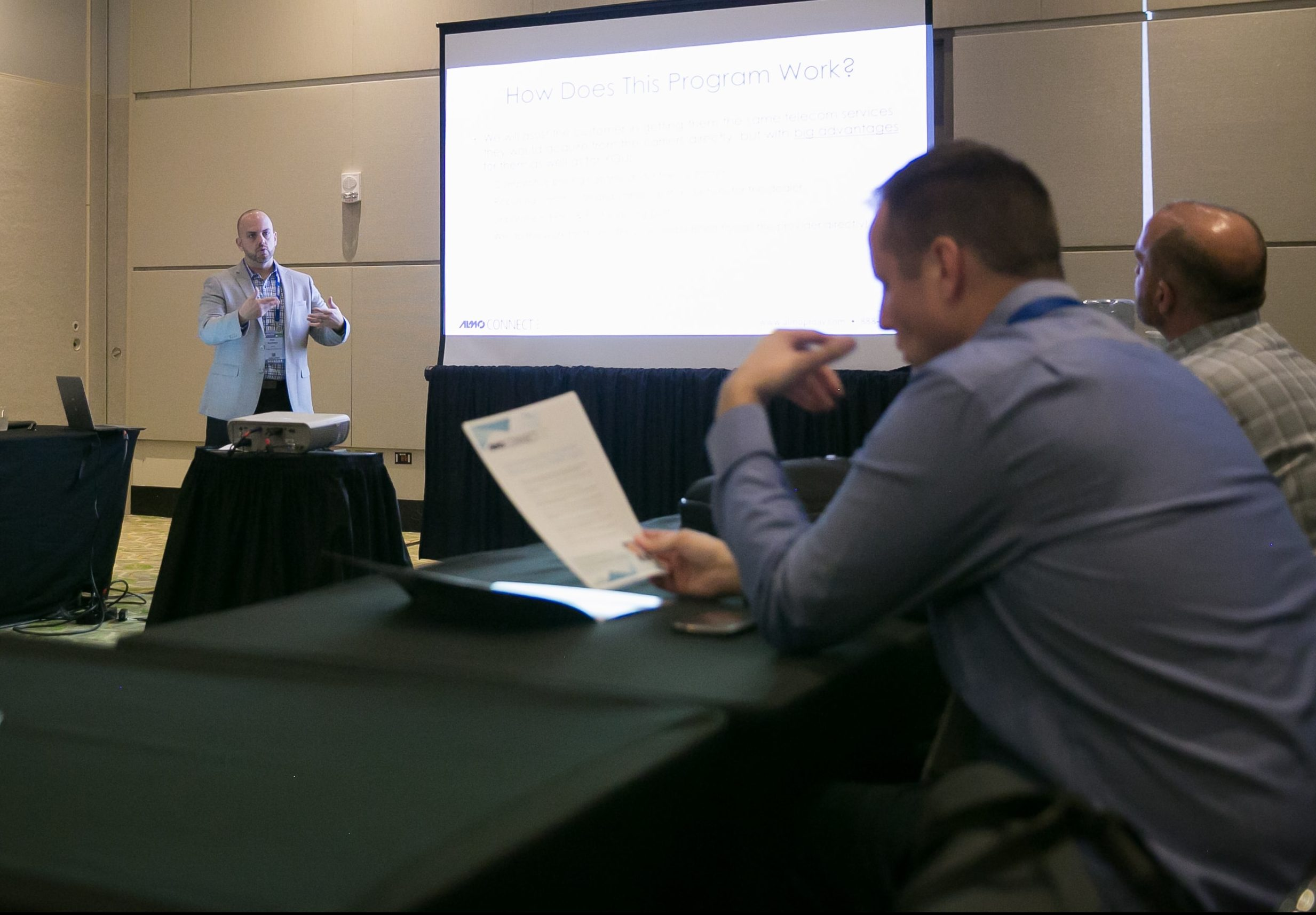Rob Voorhees gives a presentation during a boardroom meeting.